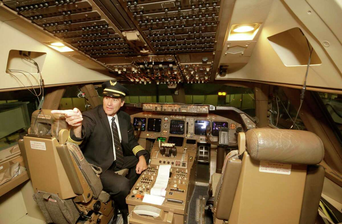 Dean McDavid, a captain and director of flight standards for United Airlines, gives a tour of a 747 cockpit at Bush Intercontinental Airport Wednesday, Oct. 18, 2017, in Houston before a farewell flight. United Airlines is retiring its Boeing 747 aircraft.