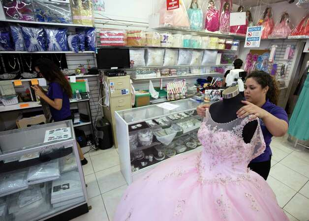 Business at Lety's Quinceañera has seen a decrease in the months following president Donald Trump's inauguration Saturday, Oct. 7, 2017, in Houston. Lety Alcocer, owner of the once-thriving 12-year-old business said the SB-4 and anti-immigrant rhetoric are hurting her business. Clients have cancelled or postponed events out of fear, she added. Photo: Godofredo A. Vasquez, Houston Chronicle / Godofredo A. Vasquez