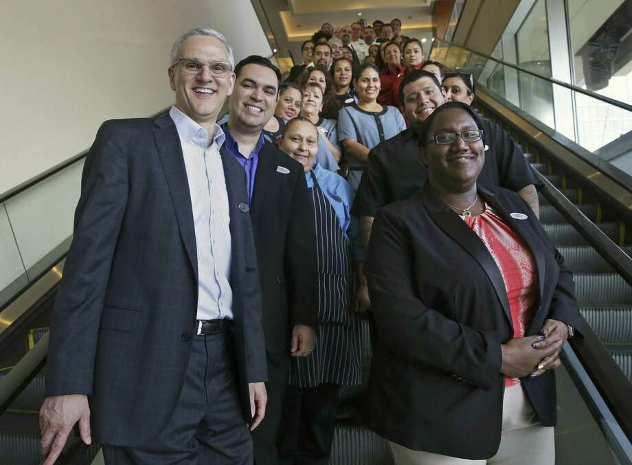 Grand Hyatt General Manager Ed Bucholtz poses with employees at his hotel. Click through to see the 14 other San Antonio-area companies that were honored as a Top Workplace: Large employer for 2017. Photo: Tom Reel /San Antonio Express-News / 2017 SAN ANTONIO EXPRESS-NEWS