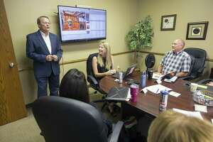 Reagan Greer (left) San Antonio division president for JB Goodwin Realtors, says hello to new realtors during a training session at the company's north side office.