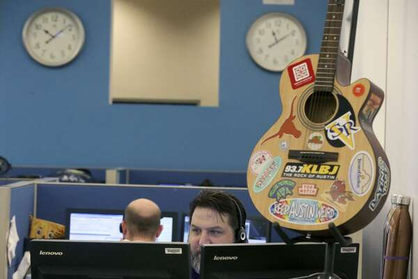 Joe Postello (facing) works Thursday October 5, 2017 at the San Antonio Marriott Engagement Center. The center handles more than 6.6 million calls each year and is the second largest customer engagement center for Marriott International. It has been named one of San Antonio's Top Workplaces for all nine years of the award. The guitar on display is a gift from their sister center in Austin, Texas.