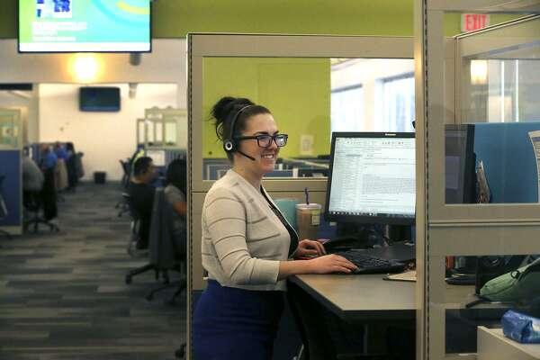 Lauren Gutierrez works at a height-adjustable desk  at the San Antonio Marriott Engagement Center. It's one of six companies to be named among San Antonio's Top Workplaces for all nine years of the award.