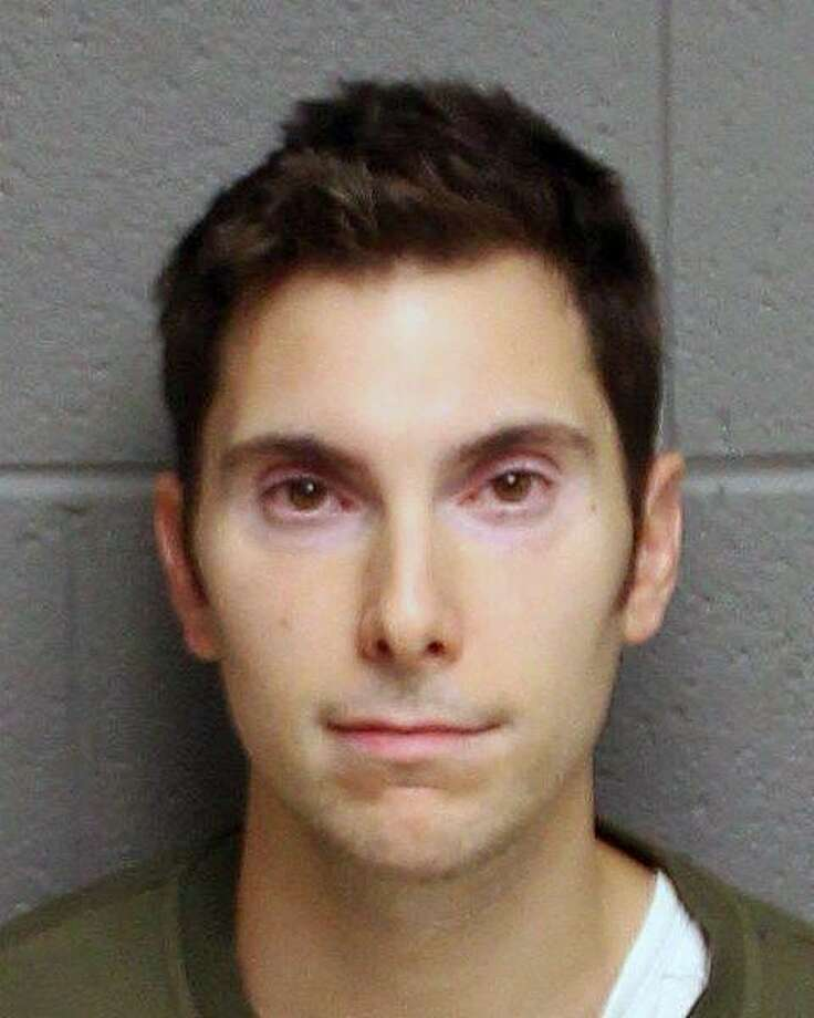 Joseph Grosso, 33, of Trumbull, was charged with first-degree robbery, second-degree robbery and criminal possession of a firearm, police said. Photo: Contributed Photo / Monroe Police Department / Contributed Photo / Connecticut Post Contributed