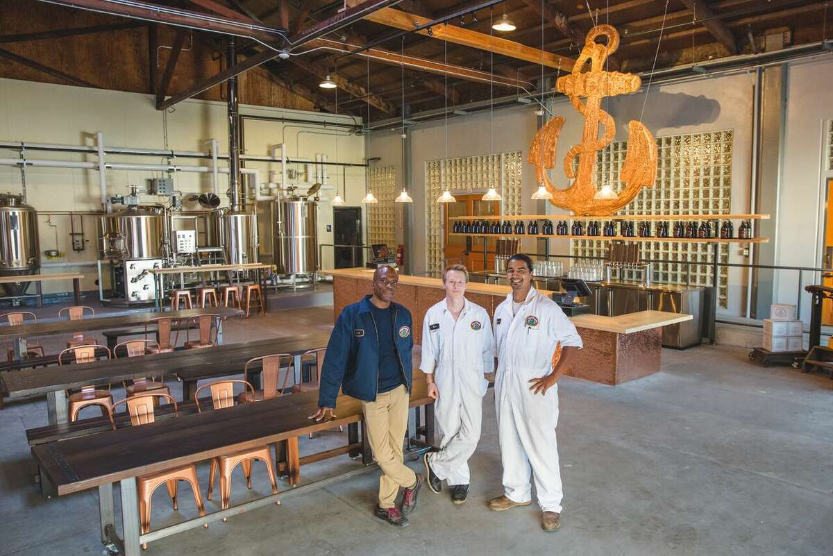 Anchor Brewing Company will soon open Anchor Public Taps, its first public taproom since before Prohibition. Pictured (from L-R): Director of Hospitality Derek Hunter, Pilot Brewer Dane Volek, and Lead Brewer Ramon Tamayo.