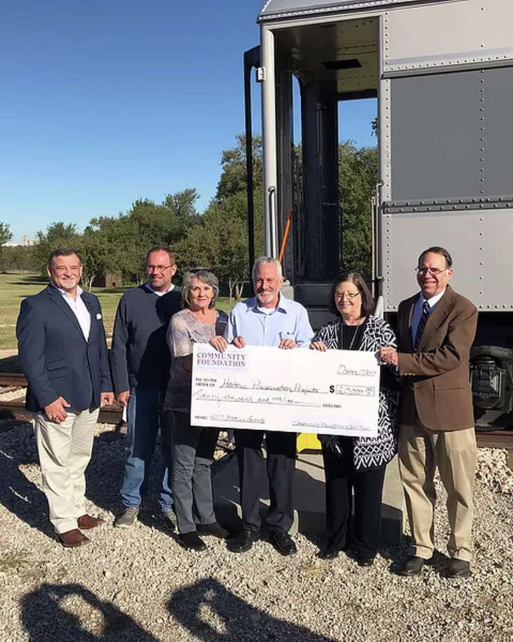 The E. Jay Matsler Trust for Historic Preservation awarded $20,000 in grants to four groups Tuesday, including Plainview Downtown Restoration for exterior lighting at the Skaggs Building. Shown with a ceremonial check are, from left, Mark Meurer and Glen Culver, Slaton Railroad Heritage Association, caboose interior restoration project; Sandy Fortenberry, Lubbock County Courthouse Commission, cannon restoration project; Stephen Warren, president, Community Foundation of West Texas; Cindy Martin, Lubbock Heritage Society, Underwood Pullman Car preservation project; and Blair Willson, Plainview Downtown Restoration, Skaggs Building east entry and exterior lightning restoration.