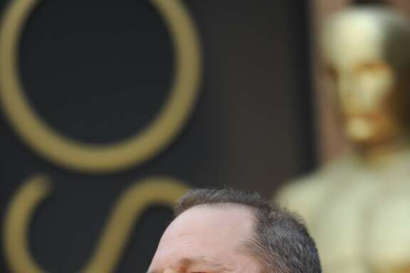 (FILES) This file photo taken on March 2, 2014 shows producer Harvey Weinstein arriving on the red carpet for the 86th Academy Awards in Hollywood, California.  Weinstein, the disgraced Hollywood mogul fighting decades of sexual abuse and harassment allegations, resigned on October 17, 2017, from the board of directors of the production company he co-founded, Variety reported. / AFP PHOTO / ROBYN BECKROBYN BECK/AFP/Getty Images