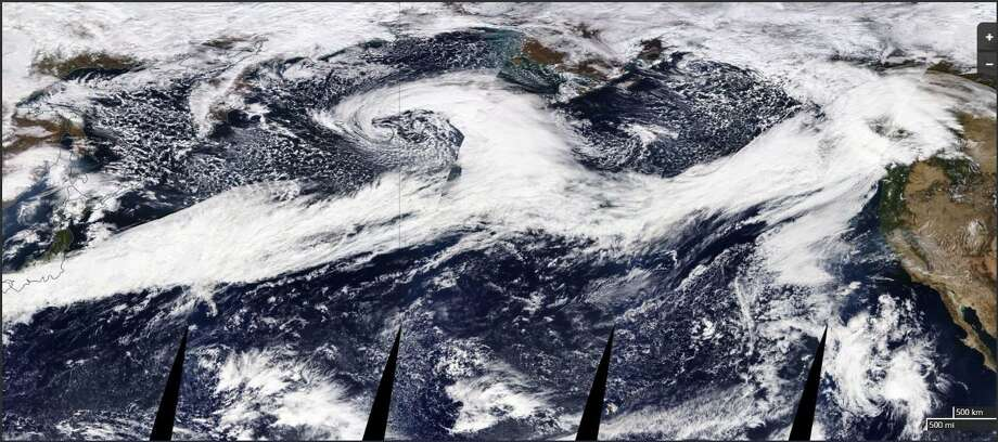 A string of weather systems stretched all the way across the Pacific Monday. Rain and wind Wednesday was being fueled by those storms moving inland. Photo: National Weather Service