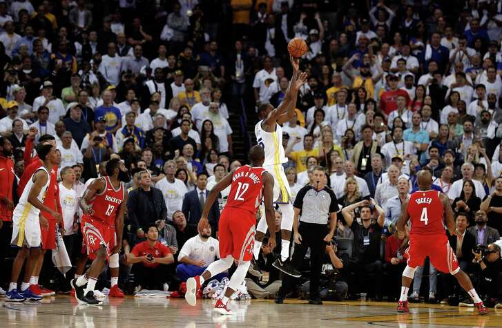 Kevin Durant (35) puts up a last second shot attempt to win the game in the second half as the Golden State Warriors played the Houston Rockets at Oracle Arena in Oakland, Calif., Tuesday, October 17, 2017. Durant's shot was ruled no good after video review and the Warriors lost 122-121.
