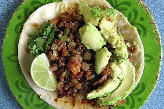 Carne asada a la mexicana taco with avocado on a handmade flour tortilla from Taquería Fiesta Charra.