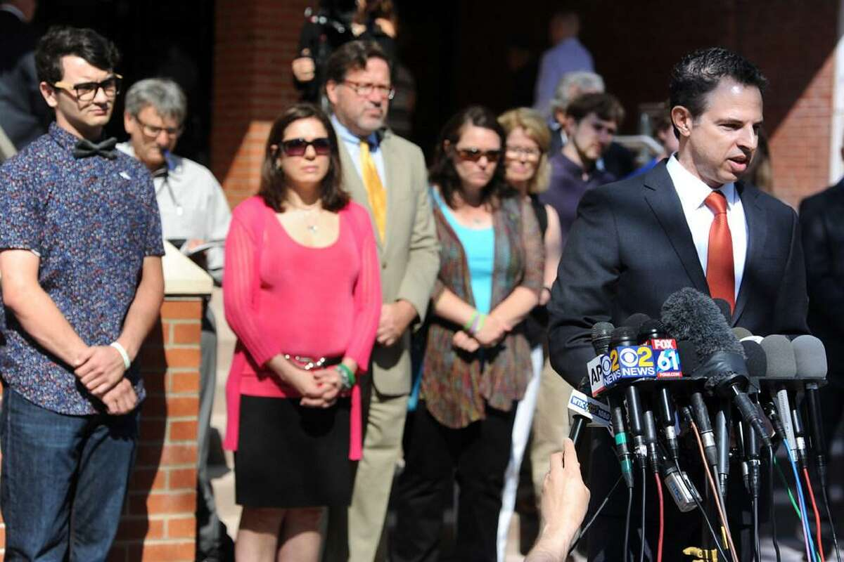Attorney Joshua Koskoff with Sandy Hook family members in 2016.