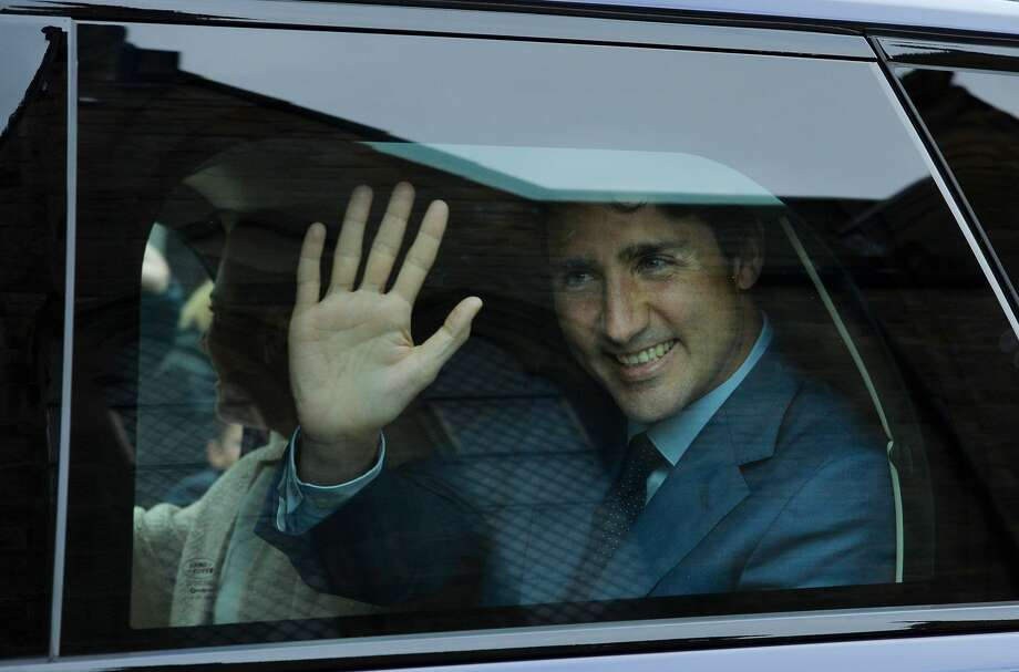 Canadian Prime Minister Justin Trudeau waves to crowds from his Range Rover outside Holyroodhouse after an audience with The Queen at Holyroodhouse on July 5, 2017 in Edinburgh, Scotland. Canadian Prime Minister Justin Trudeau has been spending some time in Scotland ahead of attending the G20 summit in Hamburg, Germany. Photo: Mark Runnacles/Getty Images