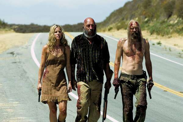 © 2004 Lions Gate Films. All Rights Reserved. Credit: Eric Lee Sheri Moon Zombie (as Baby), Sid Haig (as Capt. Spaulding) and Bill Moseley (as Otis Driftwood) in THE DEVIL'S REJECTS. Photo credit: Gene Page