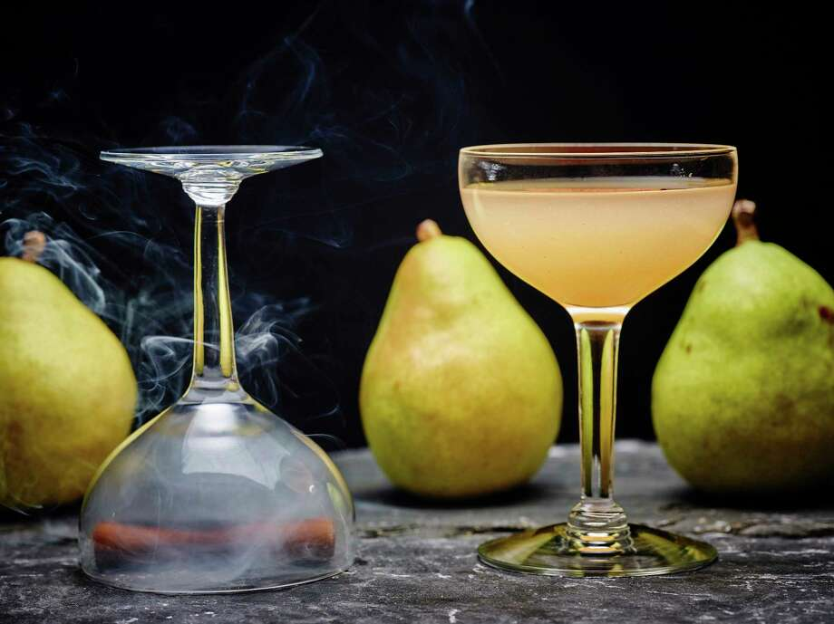 This Oct. 6, 2017 photo provided by The Culinary Institute of America shows a Spiced Orchard Pear Cocktail in Hyde Park, N.Y. This cocktail is from a recipe by the CIA. (Phil Mansfield/The Culinary Institute of America) ORG XMIT: NYCI102 Photo: Phil Mansfield / © 2017 The Culinary Institute of America - Phil Mansfield