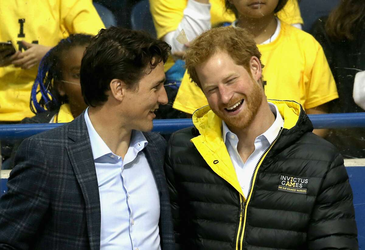 Prince Harry chats with Canadian Prime Minister Justin Trudeau as they watch a sledge-hockey match Mattany at the Athletic Centre on May 2, 2016 in Toronto, Canada. Prince Harry is in Toronto for the Launch of the 2017 Toronto Invictus Games before heading down to Miami and the 2016 Invictus Games in Orlando. (Photo by Chris Jackson/Getty Images)