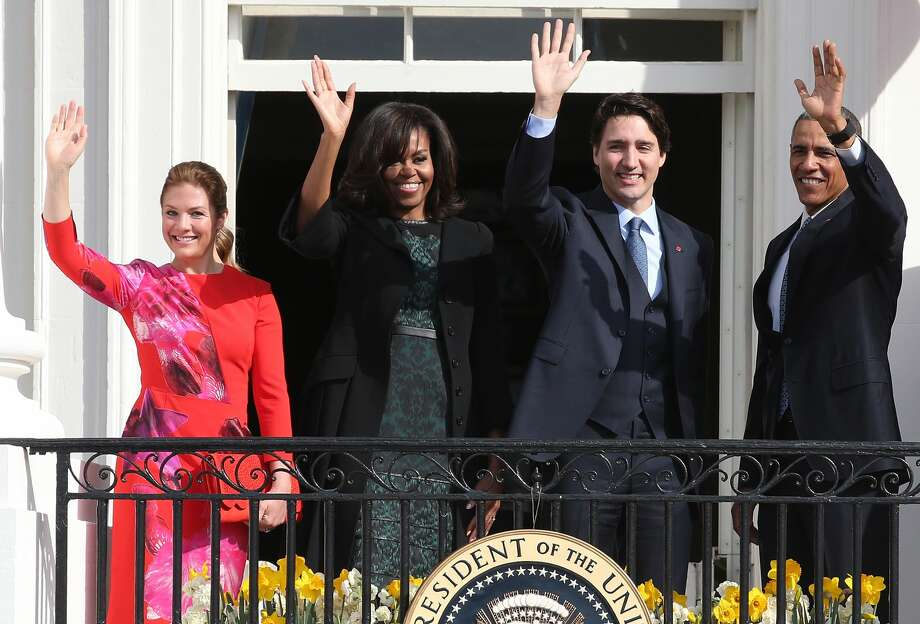 U.S. President Barack Obama (R) and Canadian Prime Minister Justin Trudeau (2nd R), U.S. first lady Michelle Obama (2nd L) and Sophie Grégoire-Trudeau wave to invited guests from the Truman Balcony of the White House after an arrival ceremony at the White House, March 10, 2016 in Washington, DC. This is Trudeau's first trip to Washington since becoming Prime Minister. (Photo by Mark Wilson/Getty Images) Photo: Mark Wilson/Getty Images