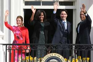 U.S. President Barack Obama (R) and Canadian Prime Minister Justin Trudeau (2nd R), U.S. first lady Michelle Obama (2nd L) and Sophie Grégoire-Trudeau wave to invited guests from the Truman Balcony of the White House after an arrival ceremony at the White House, March 10, 2016 in Washington, DC. This is Trudeau's first trip to Washington since becoming Prime Minister. (Photo by Mark Wilson/Getty Images)