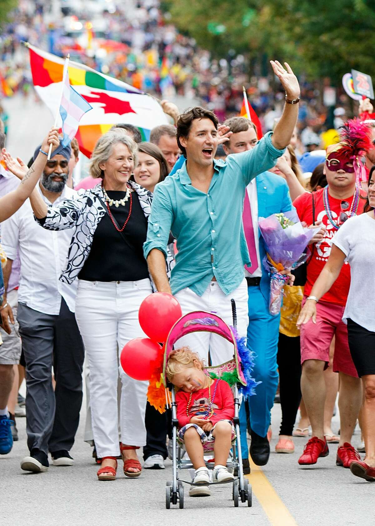 Prime Minister of Canada Justin Trudeau (C) pushes his youngest son Hadrien Trudeau in a stroller during the 38th Annual Vancouver Pride Parade on July 31, 2016 in Vancouver, Canada. (Photo by Andrew Chin/Getty Images)