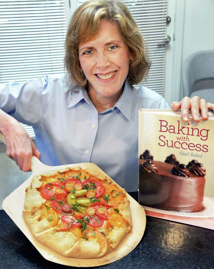 "Gail Sokol, chef educator at Schenectady County Community College, with an heirloom tomato tart from her new cookbook, ""Baking with Success"" in her kitchen Wednesday Oct. 4, 2017 in Slingerlands, NY.  (John Carl D'Annibale / Times Union) Photo: John Carl D'Annibale / 20041747A"