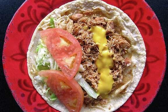 Stewed chicken taco on a handmade corn tortilla from Mi Tequila Jalisco.