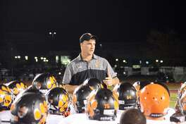 Edwardsville football coach Matt Martin talks to his team after a 45-14 victory over Belleville West on Oct. 13 in Belleville.