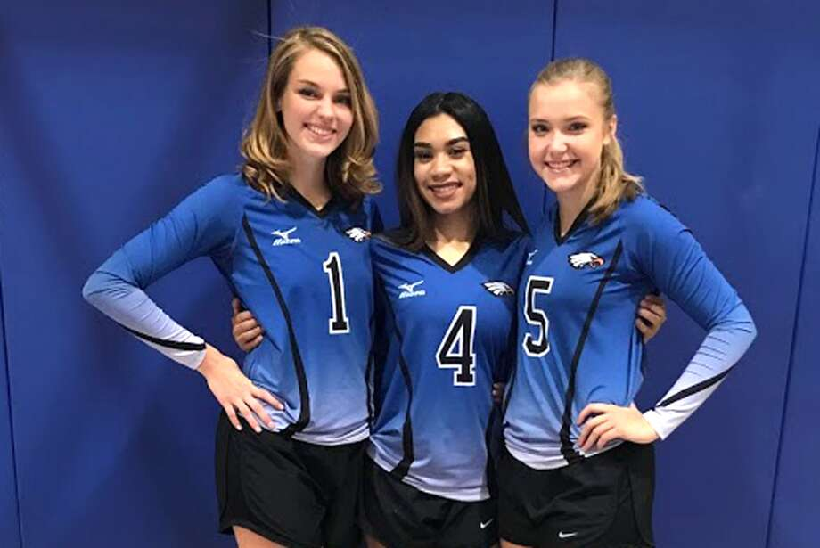 Plainview Christian Academy senior volleyball players from left, Kylee Hill, Emiley Sanchez and Stephanie Stukey, were honored Tuesday night as they were playing in their final regular-season home match at the Eagles' Nest. PCA beat Lubbock Christ the King in three sets. Photo: Courtesy Photo