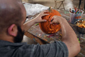 Maurice Abelman carves a Pumpkin at at the Art Studio in Beuamont. Photo taken Wednesday, October 12, 2017 Guiseppe Barranco/The Enterprise