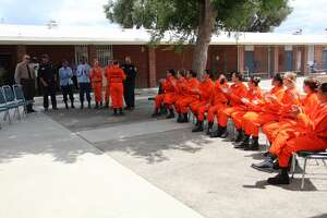A graduating class of female inmate firefighters who have completed their training at the California Institution for Women in Chino.
