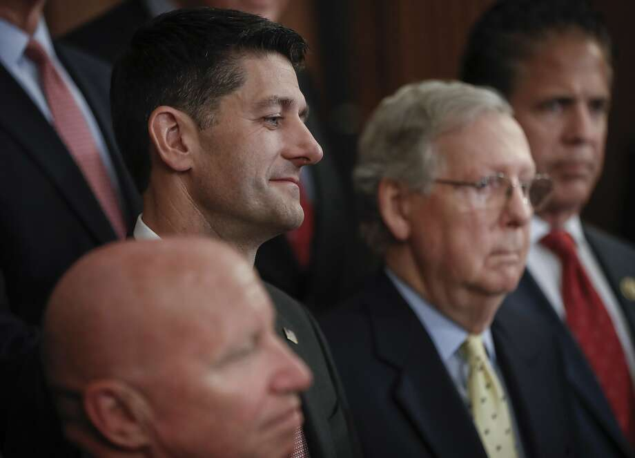 House Speaker Paul Ryan (left) and Senate Majority Leader Mitch McConnell have come under attack from the base of their own Republican Party. Photo: Pablo Martinez Monsivais, Associated Press