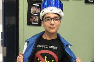 "Brazoswood homecoming king Joel allegedly was bullied after winning with shirts that read ""#NotMyKing."" He took it in stride and rocked the shirt with his crown on his head regardless of the haters. Source:  Facebook"