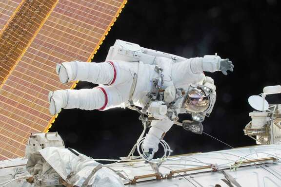 Expedition 46 Commander Scott Kelly participates in a spacewalk outside the International Space Station.
