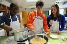 From left; Sophomores Derick Celestin, Nick Gloria, and Amanda Zdru cook potato gnocci in a chicken veloute in their Intro to Culinary Arts class at Bunnell High School in Stratford, Conn. on Wednesday, October 18, 2017. With their teacher, Brian Neumeyer, the students will be cooking once monthly meals for Stratford veterans.