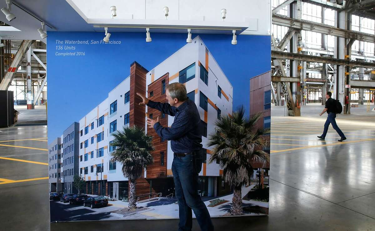 CEO Rick Holiday explains how they constructed the Waterbend complex in San Francisco completed in 2016. Displayed inside the huge building at Factory_OS, where they are ramping up to build well-designed, tech-ready multifamily homes 40% faster and 20% less expensive than conventional housing on the grounds of the famous Mare Island Naval Shipyard in Vallejo, Ca., as seen on Mon. September 11, 2017.