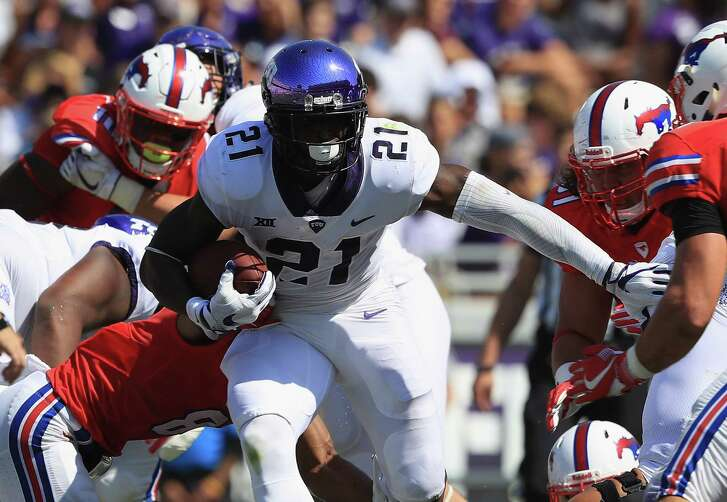 FORT WORTH, TX - SEPTEMBER 16:  Kyle Hicks #21 of the TCU Horned Frogs runs the ball against the Southern Methodist Mustangs at Amon G. Carter Stadium on September 16, 2017 in Fort Worth, Texas.  (Photo by Ronald Martinez/Getty Images)