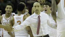 Texas Longhorns head coach Shaka Smart congratulates his team during the Lone Star Shootout game against Arkansas at the Toyota Center on Saturday, Dec. 17, 2016, in Houston.