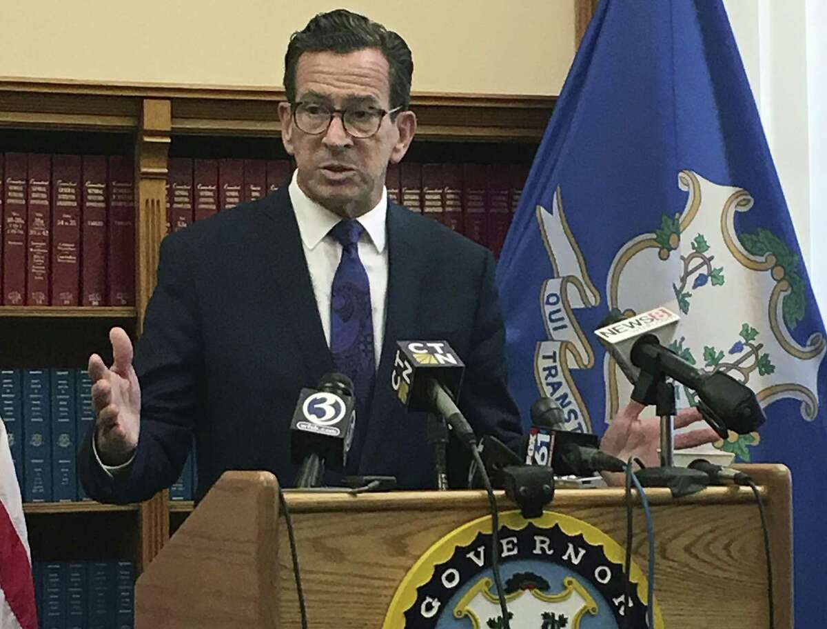 Connecticut Gov. Dannel P. Malloy speaks after top state legislative leaders said they had reached an agreement on a tentative framework for a new two-year budget, Wednesday, Oct. 18, 2017, at the Capitol in Hartford, Conn.