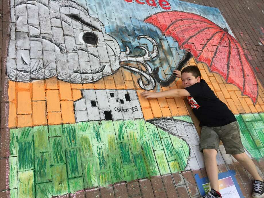 "San Antonio Independent School District students won the Team Works elementary category at the Oct. 14, 2017 Chalk It Up event downtown for their interactive mural titled ""Si Se Puede."" Photo: Courtesy/San Antonio Independent School District"