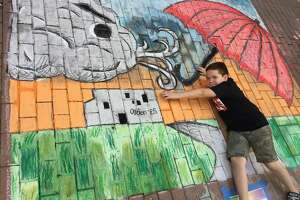 "San Antonio Independent School District students won the Team Works elementary category at the Oct. 14, 2017 Chalk It Up event downtown for their interactive mural titled ""Si Se Puede."""