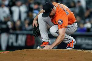 Houston Astros starting pitcher Lance McCullers Jr. searches for diamonds from a broken necklace on the pitchers mound during Game 4 of the ALCS against the New York Yankees at Yankee Stadium on Tuesday, Oct. 17, 2017, in New York.