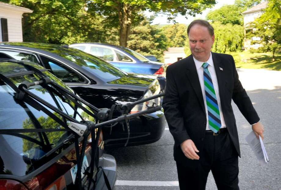 State Sen. Michael McLachlan enters the law offices of Cramer and Anderson, in New Milford, for a deposition as part of the Danbury 11 civil rights lawsuit on Friday, June 25, 2010. Photo: Michael Duffy / The News-Times