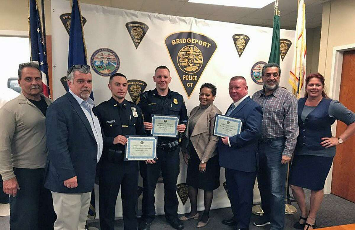 From left to right: Police Commissioner Thomas Lyons, Police Commissioner Vice Chair Daniel Roach, Officer Anthony Caiazzo, Sergeant Trevor Niestemski, Police Commissioner Valerie Quarles, Officer Douglas Bepko, Police Commissioner Hector Diaz and Police Commissioner Anna Cruz.