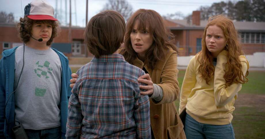 """The freaked-out mom and daring kids of Netflix's second round of horror hit """"Stranger Things."""" Pictured are Winona Ryder, Gaten Matarazzo, Noah Schnapp and a red-haired newcomer named Max (Sadie Sink). Photo: Netflix"""