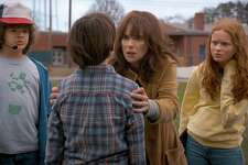 """The freaked-out mom and daring kids of Netflix's second round of horror hit """"Stranger Things."""" Pictured are Winona Ryder, Gaten Matarazzo, Noah Schnapp and red-haired newcomer Sadie Sink as Max."""