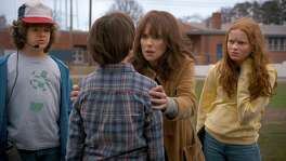 "The freaked-out mom and daring kids of Netflix's second round of horror hit ""Stranger Things."" Pictured are Winona Ryder, Gaten Matarazzo, Noah Schnapp and red-haired newcomer Sadie Sink as Max."