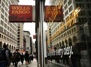 NEW YORK, NY - OCTOBER 13:  People walk by a Wells Fargo bank branch on October 13, 2017 in New York City. Wells Fargo shares were down 3.4% to�$53.34�in afternoon�trading following news that the banks quarterly profit from July through September dropped nearly 19%.  (Photo by Spencer Platt/Getty Images)