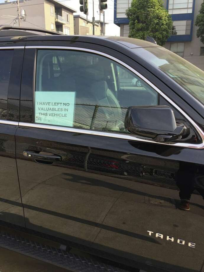 Is a sign like this one likely to discourage thieves from breaking into your car or truck? Some Reddit users who park their vehicles on San Francisco streets say it does. (Photo used with permission of Reddit user Cyberpatrolunit.) Photo: Cyberpatrolunit/Reddit
