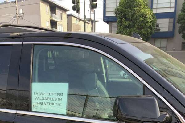 Is a sign like this one likely to discourage thieves from breaking into your car or truck? Some Reddit users who park their vehicles on San Francisco streets say it does. (Photo used with permission of Reddit user Cyberpatrolunit.)