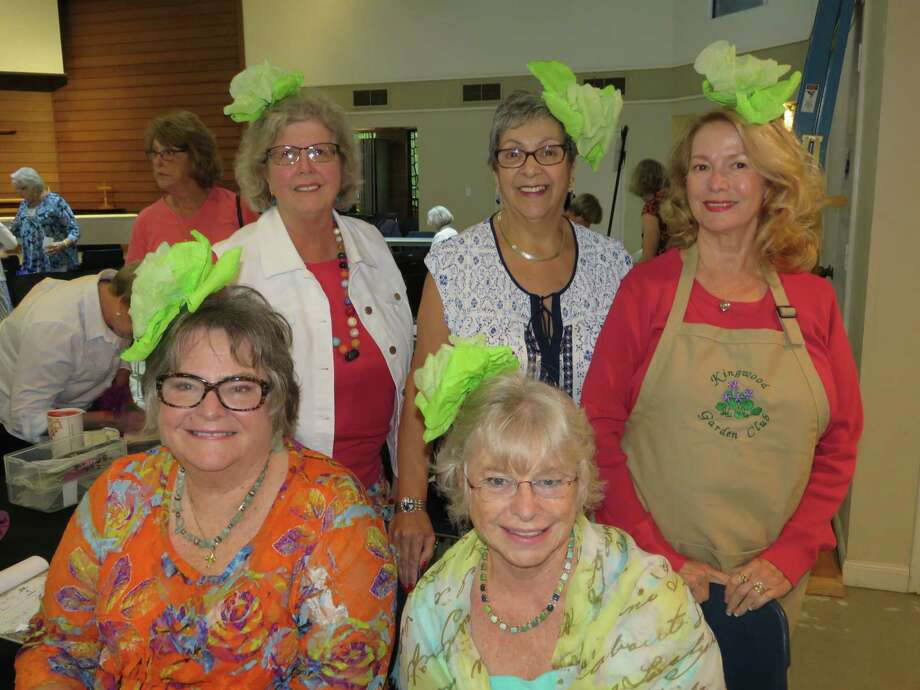 Members of the Kingwood Gardening Club wear lettuce headpieces in honor of the club meeting's emphasis on salad fixings from the garden. Photo: Courtesy