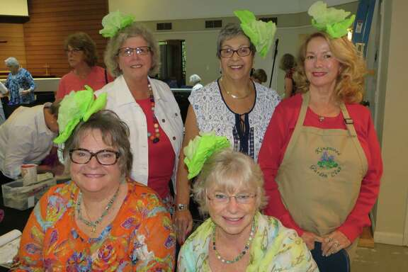 Members of the Kingwood Gardening Club wear lettuce headpieces in honor of the club meeting's emphasis on salad fixings from the garden.