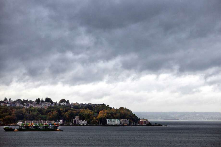Storm clouds roll in over Puget Sound, Wednesday afternoon, Oct. 18, 2017. Photo: GENNA MARTIN, SEATTLEPI / SEATTLEPI.COM
