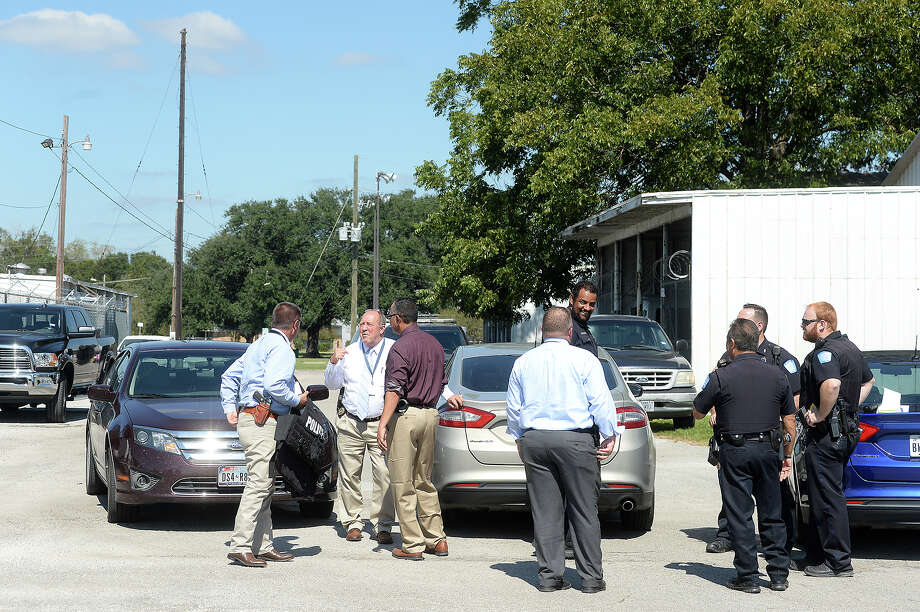 Beaumont police and detectives gather and talk behind the Best Years Senior Center following a shooting and car theft Wednesday. An elderly woman was taken for treatment to an area hospital after being shot in the head behind the facility.  Photo taken Wednesday, October 18, 2017 Kim Brent/The Enterprise Photo: Kim Brent/The Enterprise
